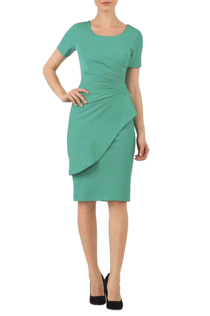 model wearing Diva Catwalk Katia short sleeve dress with an overlapped skirt and pleating across the tummy in emerald green front