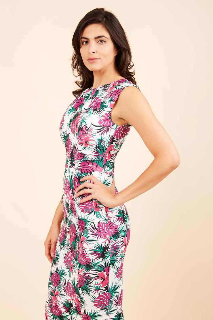 Model wearing the Diva Serenity Palm dress in pencil dress design in palm print front image