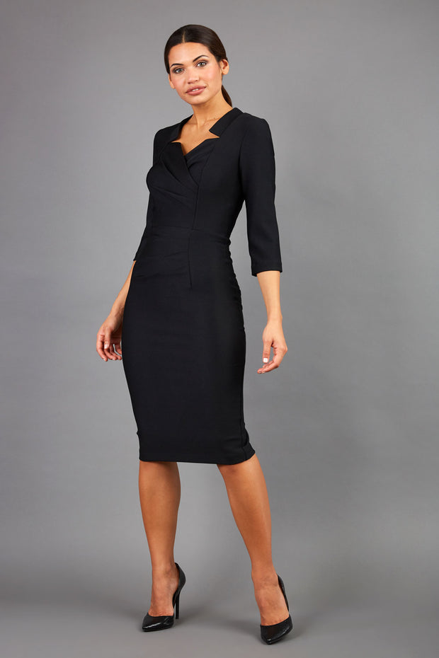 Brunette wearing seed pencil black dress front image