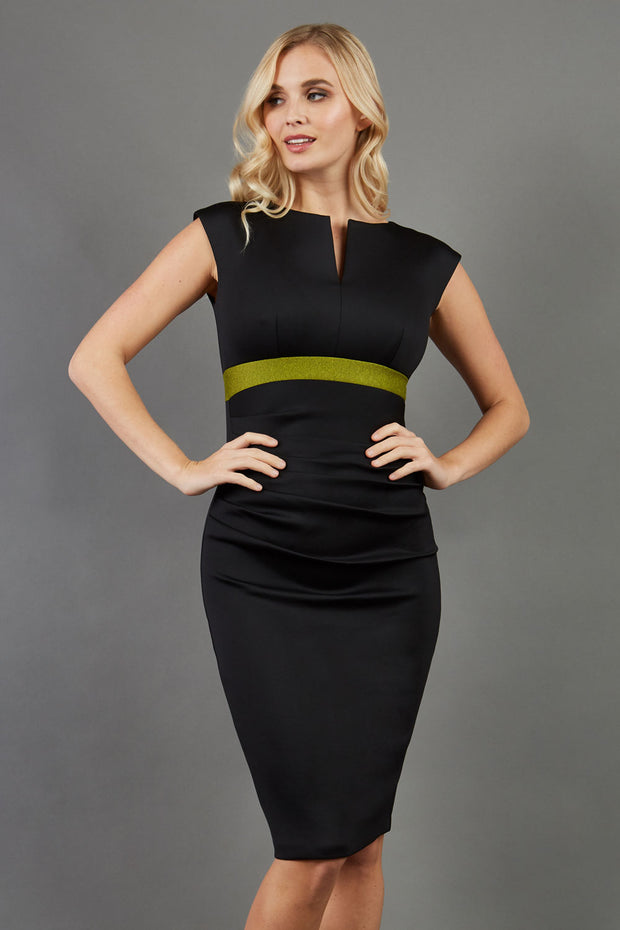 blonde model is wearing dive catwalk nadia sleeveless contrast band pencil skirt dress with rounded neckline with a slit in the middle in black front
