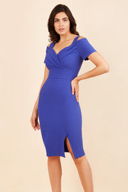brunette model wearing diva catwalk amorette pencil skirt dress with a cold shoulder detaul and pleating across the bust and slit on a side of skirt in royal blue front