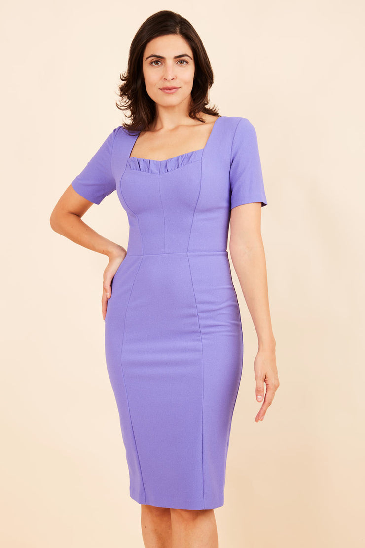 model wearing diva catwalk mitzi short sleeve pencil dress with square frilled neckline in fusion indigo  front