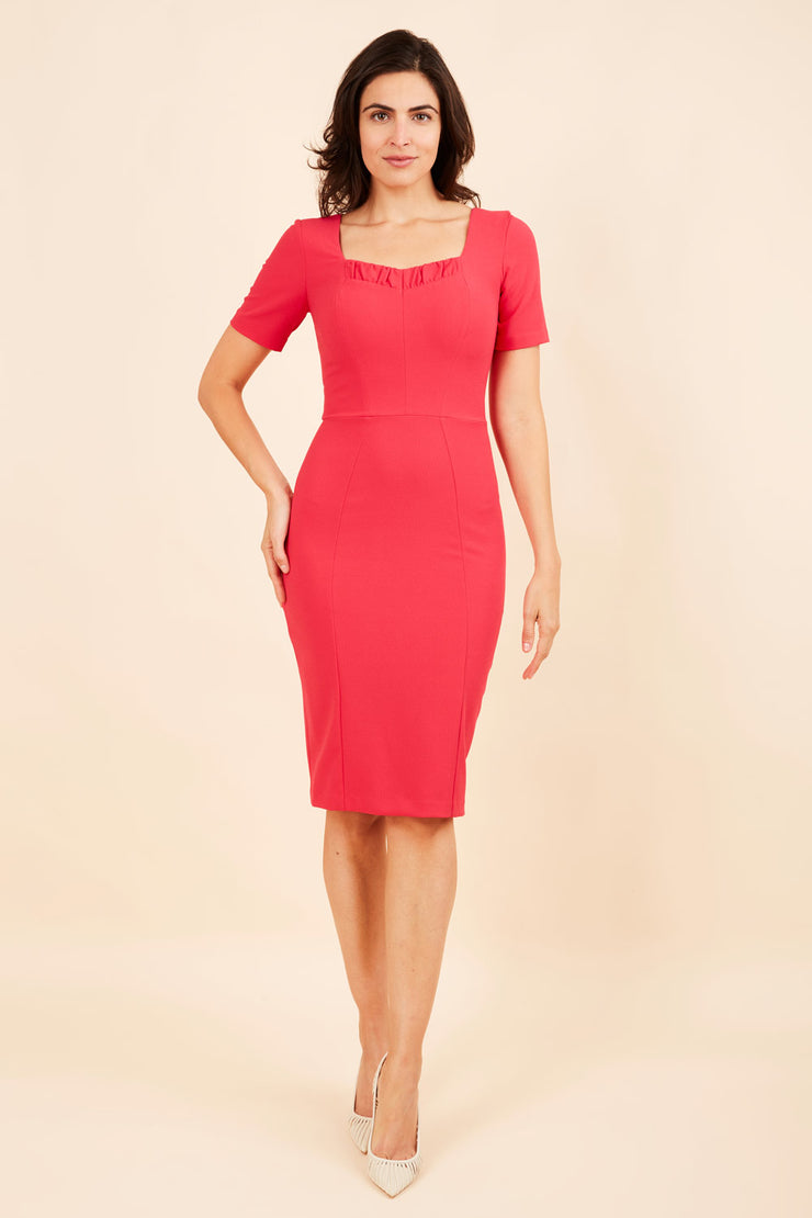 model wearing diva catwalk mitzi short sleeve pencil dress with square frilled neckline in honeysuckle pink  front