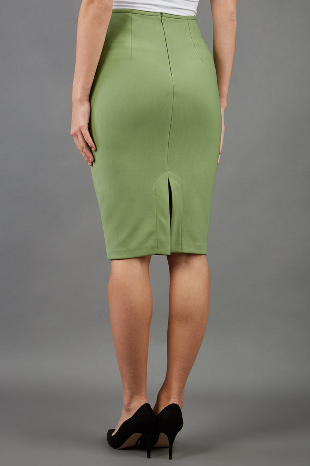 blonde model is wearing diva catwalk pencil skirt in aspen green back