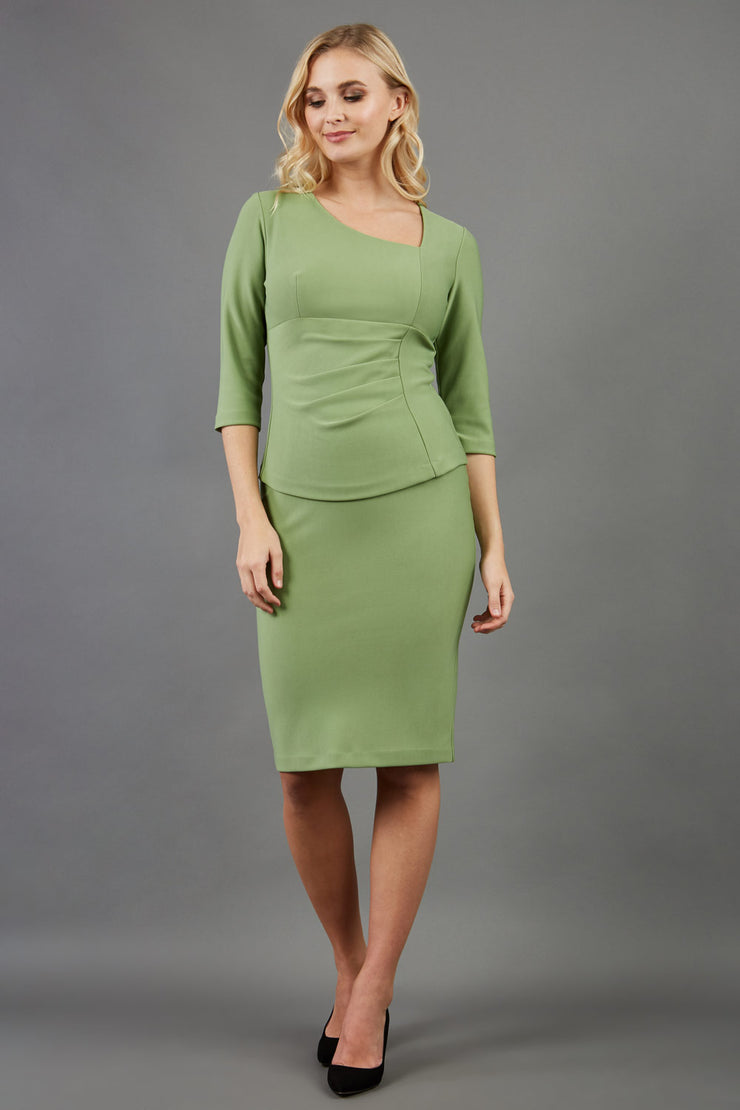 blonde model is wearing diva catwalk pencil skirt in aspen green paired with courtney sleeved top front