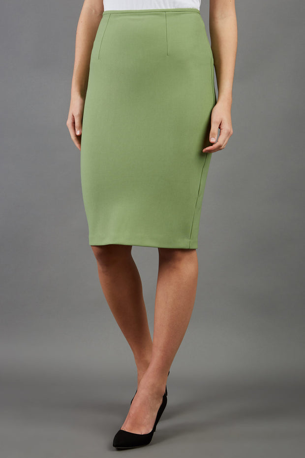 blonde model is wearing diva catwalk pencil skirt in aspen green front