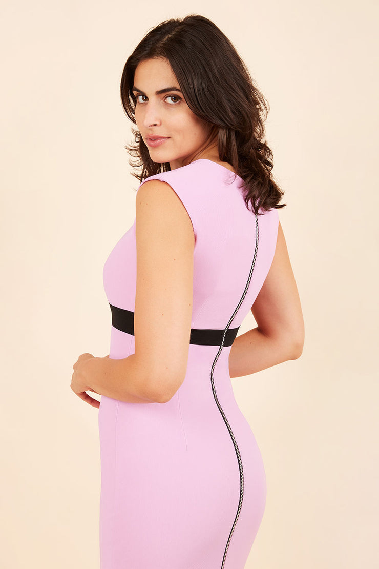 brunette model wearing diva catwalk nadia sleeveless pencil dress in pearl violet colour with a contrasting black band and exposed zip at the back with a rounded neckline with a slit  in the middle back