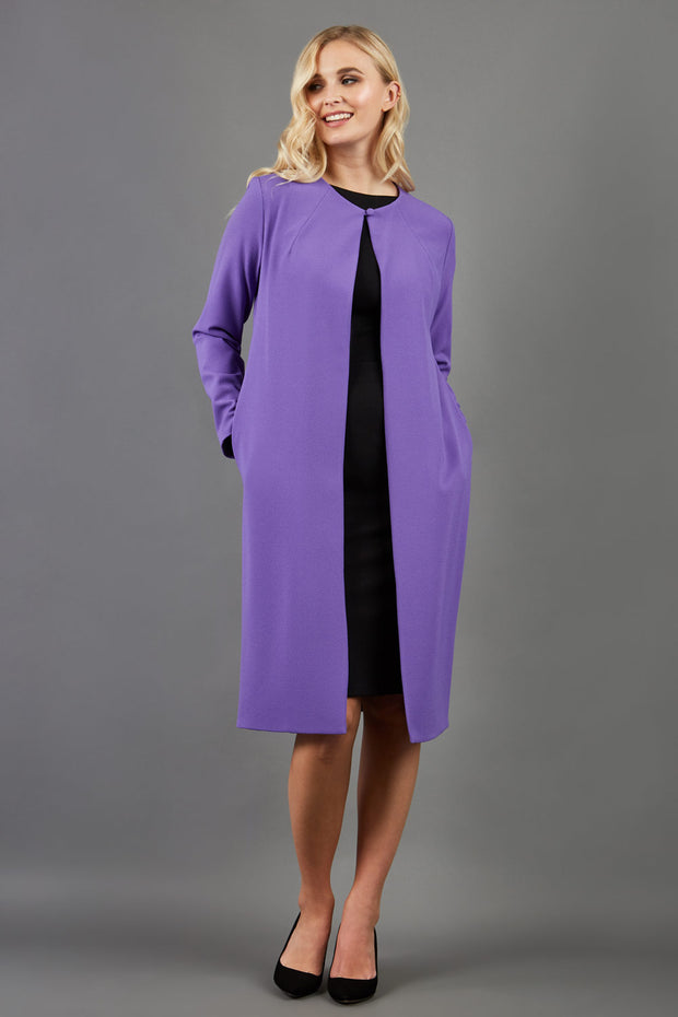 blonde model wearing the Diva Bliss Coat with round neckline in opulent violet front image