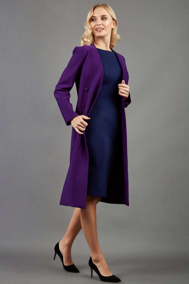 blonde model wearing the Diva Silverstone Coat with V neckline in imperial purple front image