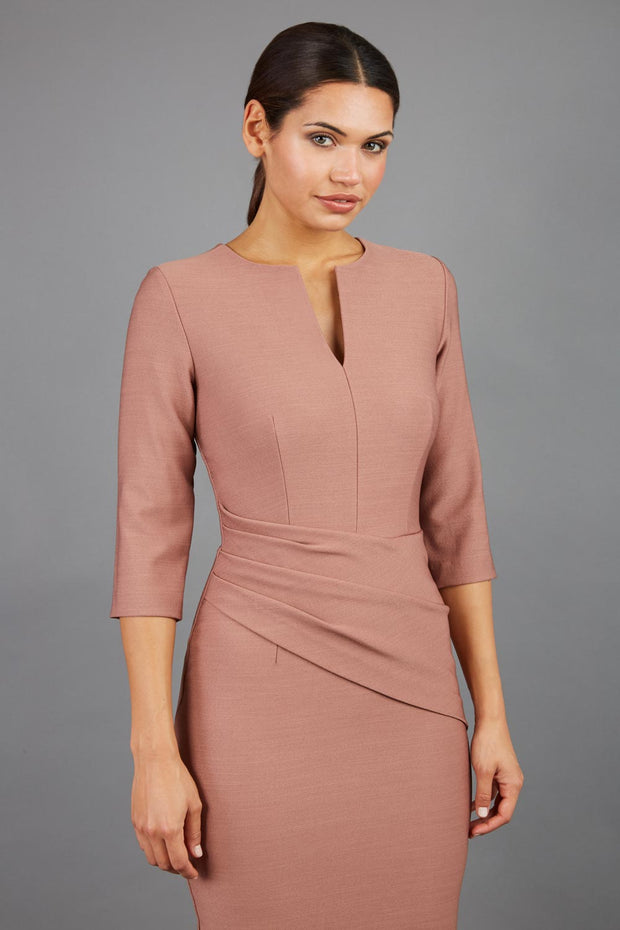 brunette model wearing seed diva catwalk milton sleeved pencil dress with a rounded neckline with a split in the middle in acorn brown front