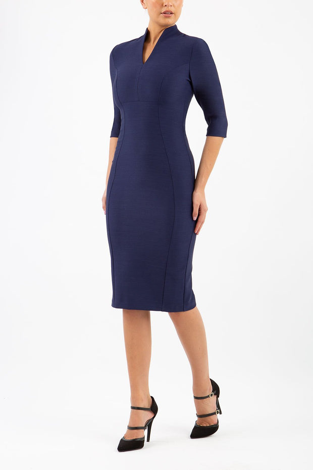 Model wearing the Seed Amalfi in pencil dress design in navy blue front image