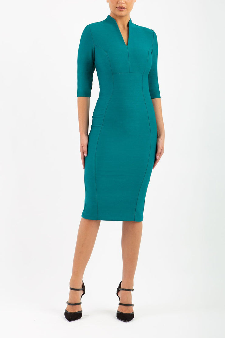 Model wearing the Seed Amalfi in pencil dress design in pacific green front image