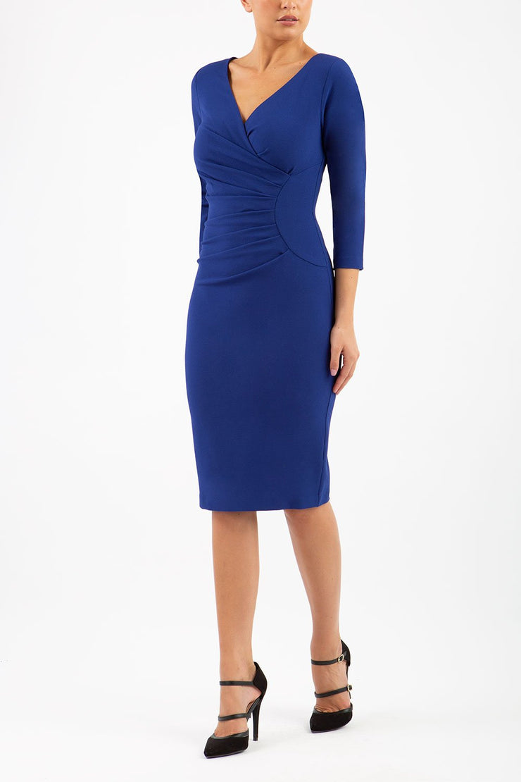 Model wearing the Diva Chelsea Pencil dress with V neckline and three-quarter sleeves in oxford blue front image