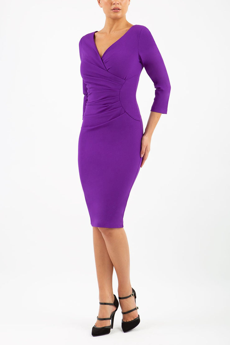 Model wearing the Diva Chelsea Pencil dress with V neckline and three-quarter sleeves in passion purple front image