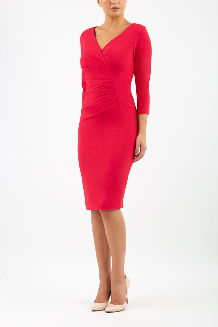 Model wearing the Diva Chelsea Pencil dress with V neckline and three-quarter sleeves in ruby red front image