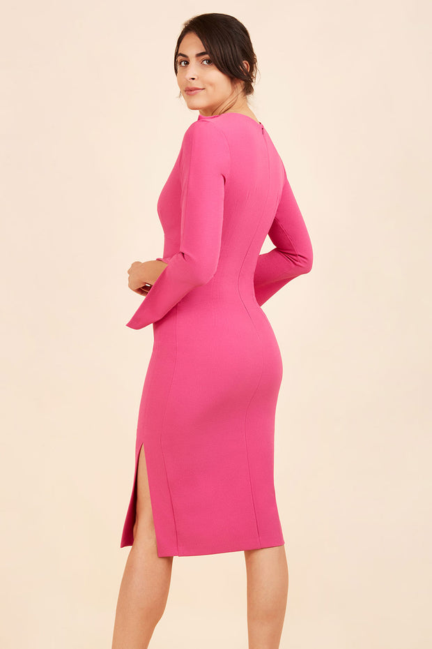 brunette model wearing diva catwalk chloe pencil skirt dress with long sleeves with deep slit and low v-neckline with tuxedo collar detailing in pink colour back