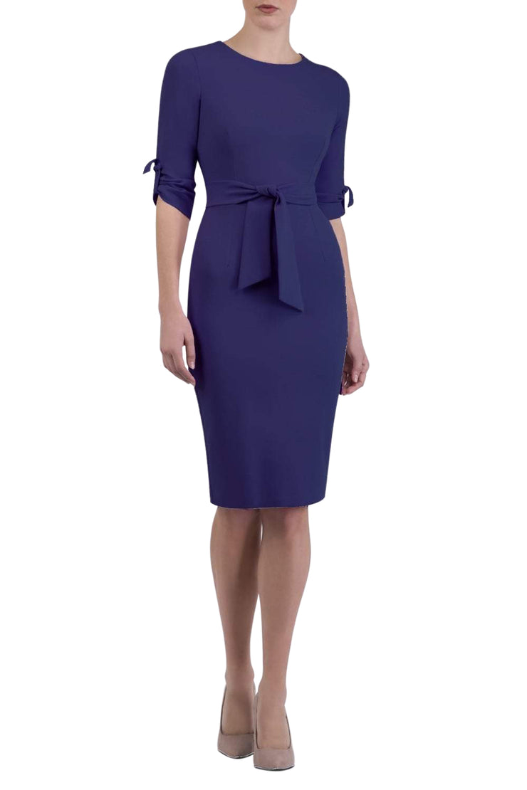 brunette model wearing diva catwalk tryst pencil navy blue dress with sleeves and belt detail at the front with rounded neckline front