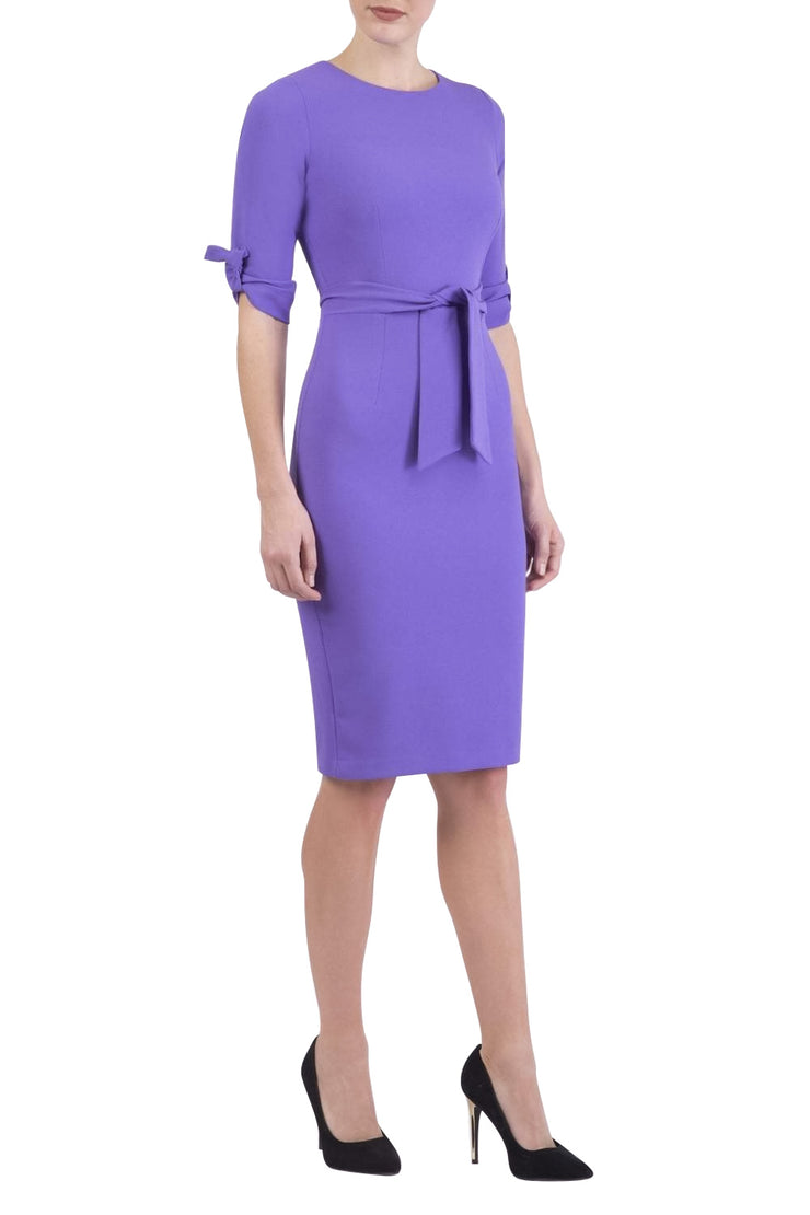 brunette model wearing diva catwalk tryst pencil opulent violet dress with sleeves and belt detail at the front with rounded neckline front