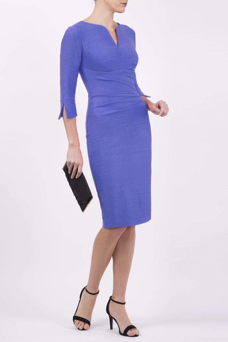 blonde model wearing seed tuscany pencil fitted dress in dawn indigo colour with a split in the neckline and split detail on sleeves front