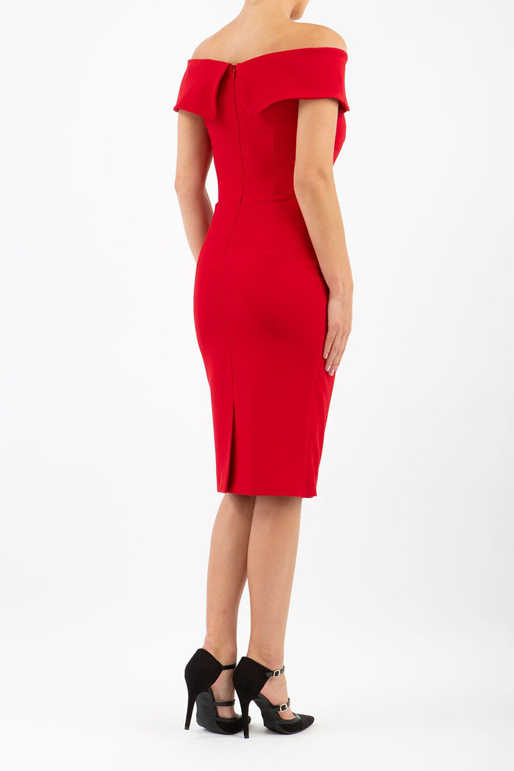 brunette model wearing diva catwalk evening pencil skirt dress sleeveless with lowered neckline and pleating on side in scarlet red  colour back