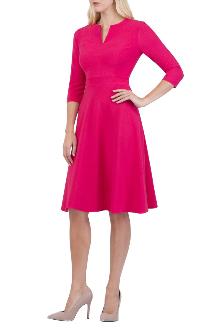 blonde model wearing diva catwalk romney three quarter sleeve swing dress with a band in honeysuckle pink front