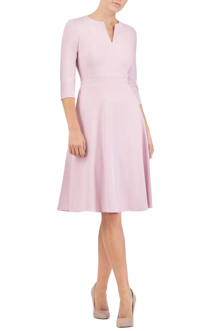 blonde model wearing diva catwalk romney three quarter sleeve swing dress with a band in dawn pink front