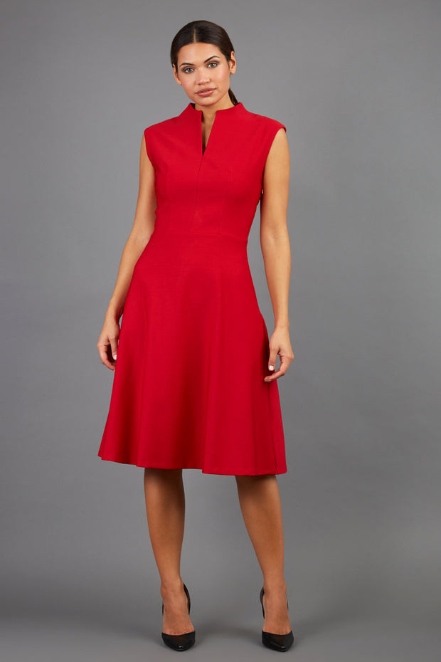 Brunette Model is wearing a sleeveless swing high neck dress in red by Diva Catwalk front image