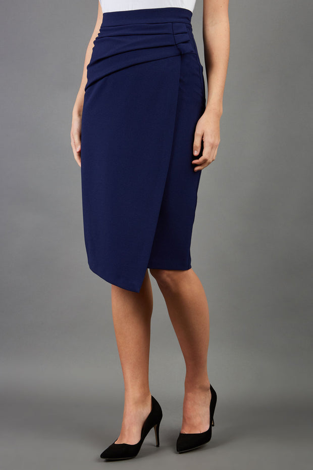 model is wearing diva catwalk antibe pencil asymmetric skirt with pleating at the front in navy front