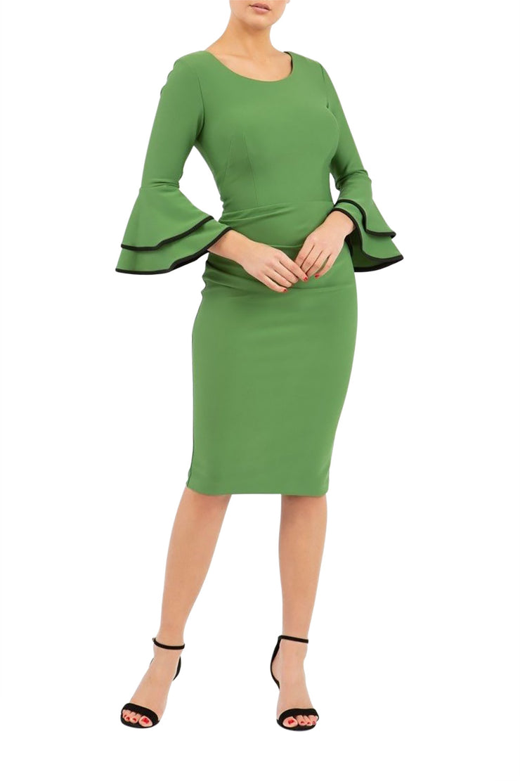 blonde model wearing diva catwalk tina pencil skirt dress with rounded neckline and flute sleeve in vineyard green front