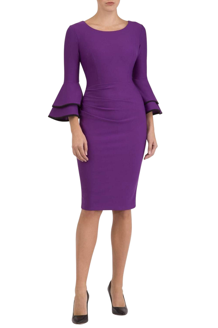 blonde model wearing diva catwalk tina pencil skirt dress with rounded neckline and flute sleeve in royal purple front
