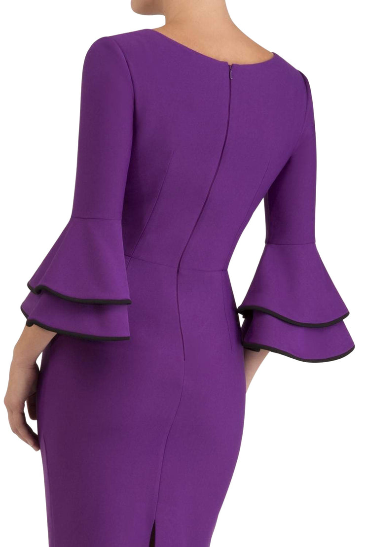blonde model wearing diva catwalk tina pencil skirt dress with rounded neckline and flute sleeve in royal purple back