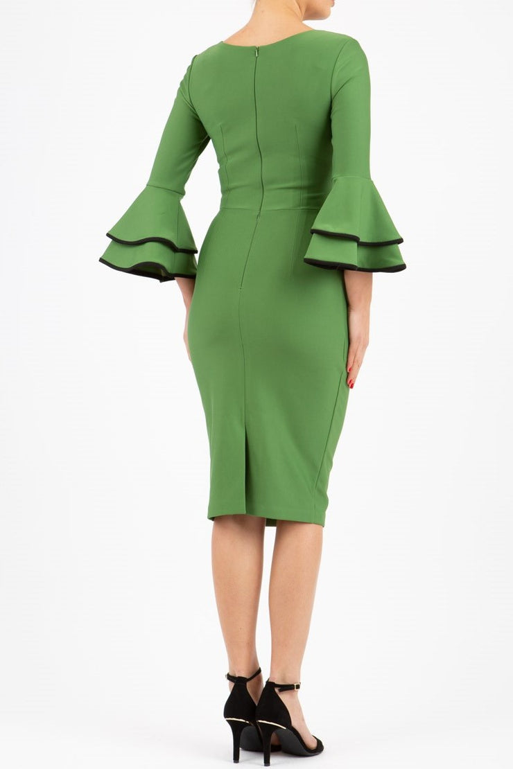 blonde model wearing diva catwalk tina pencil skirt dress with rounded neckline and flute sleeve in vineyard green back