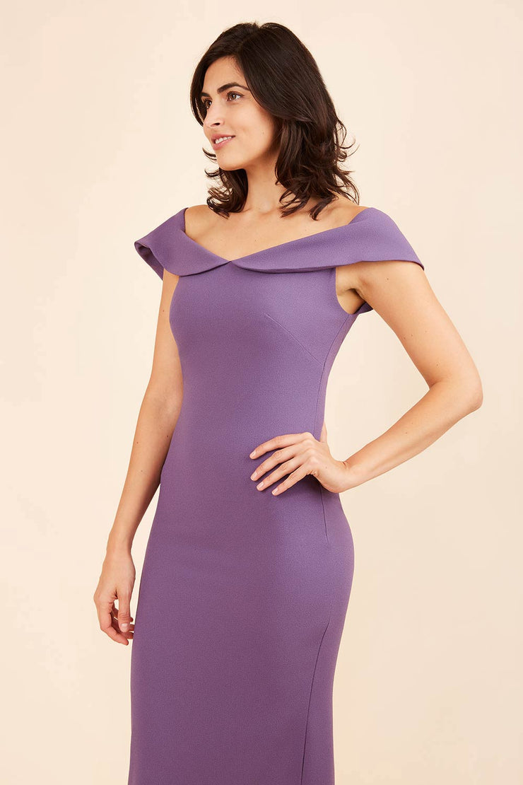 brunette model wearing diva catwalk juilet midaxi pencil sleeveless off shoulder dress with open neck and folded collar in colour mauve purple front