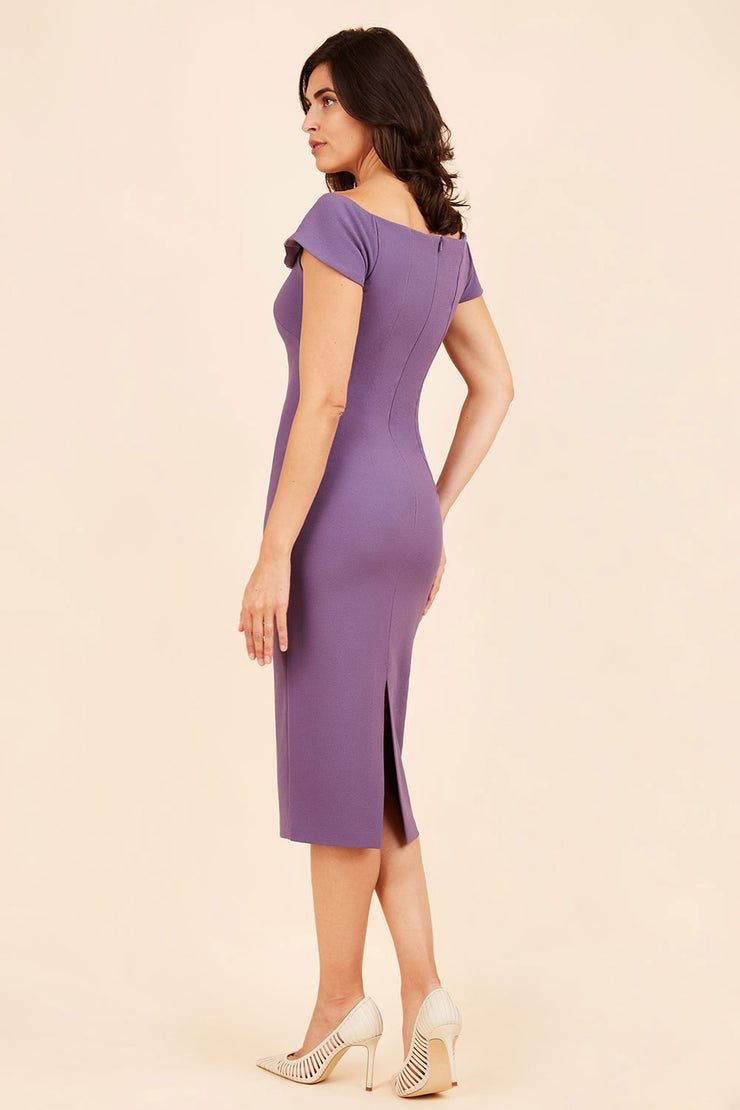brunette model wearing diva catwalk juilet midaxi pencil sleeveless off shoulder dress with open neck and folded collar in colour mauve purple back