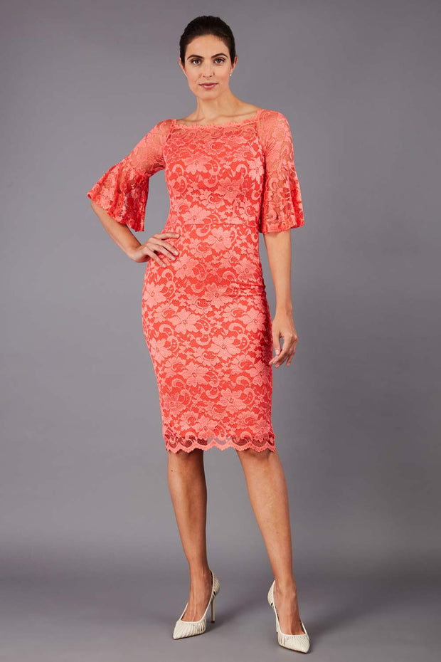 tall brunetter model wearing lace knee lenght pecill dress in orange