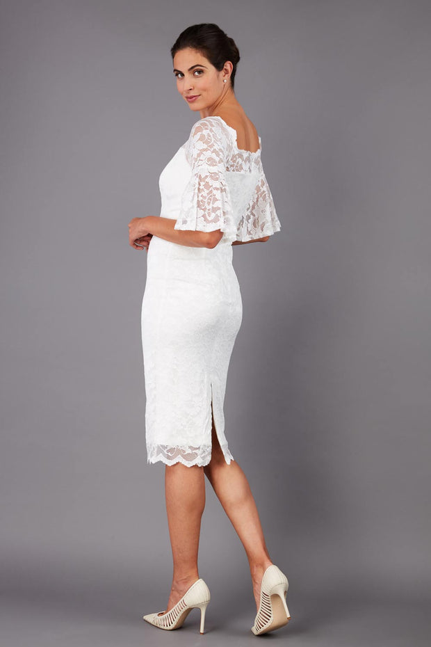 tall brunetter model wearing lace knee lenght pecill dress in ivory