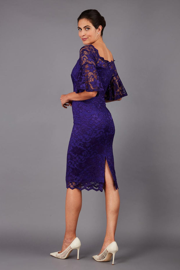 tall brunetter model wearing lace knee lenght pecill dress in spectrum indigo back image