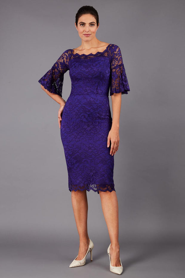 tall brunetter model wearing lace knee lenght pecill dress in spectrum indigo