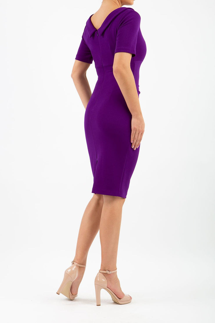 Model wearing the Diva Camille Marvel, pleat detail across front, fold at neckline in deep purple back image