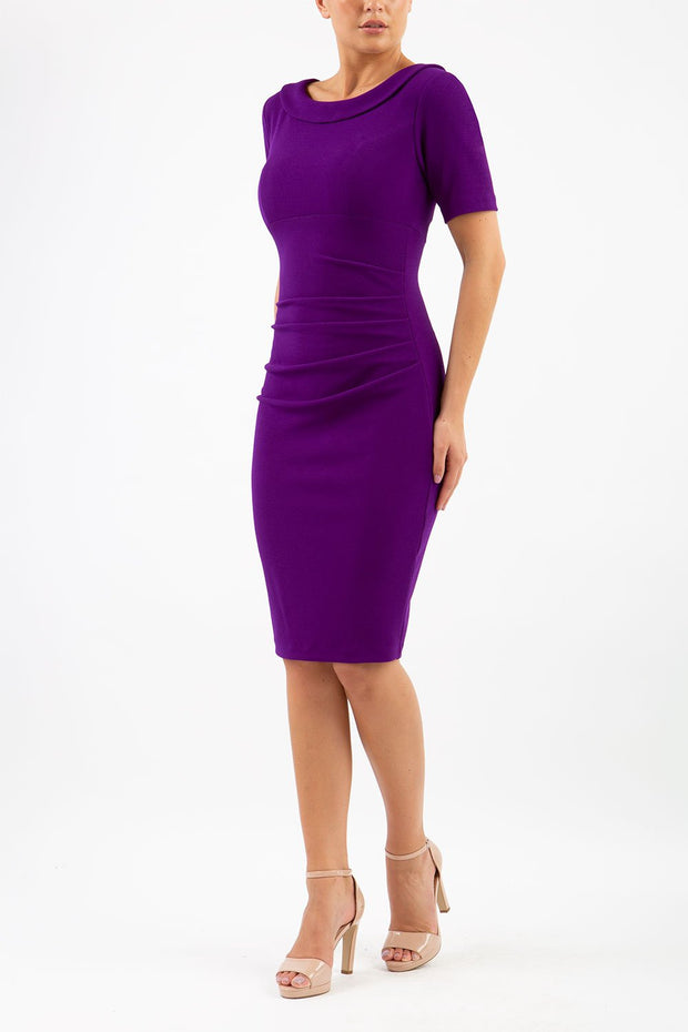 Model wearing the Diva Camille Marvel, pleat detail across front, fold at neckline in deep purple front image