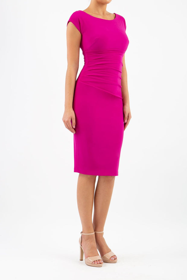 Model wearing Diva Catwalk Polly Rounded Neckline Pencil Cap Sleeve Dress with pleating across the tummy area in Magenta Haze front