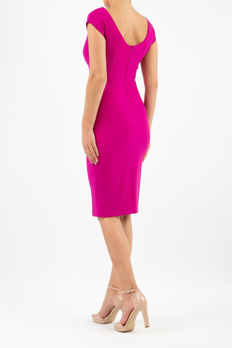 Model wearing Diva Catwalk Polly Rounded Neckline Pencil Cap Sleeve Dress with pleating across the tummy area in Magenta Haze back