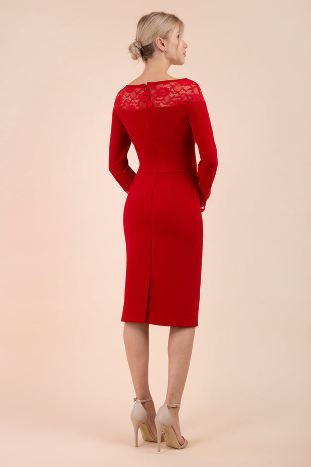 brunette model wearing diva catwalk red lace pencil dress with long sleeves and rounded lace neckline with the lace covering shoulders back