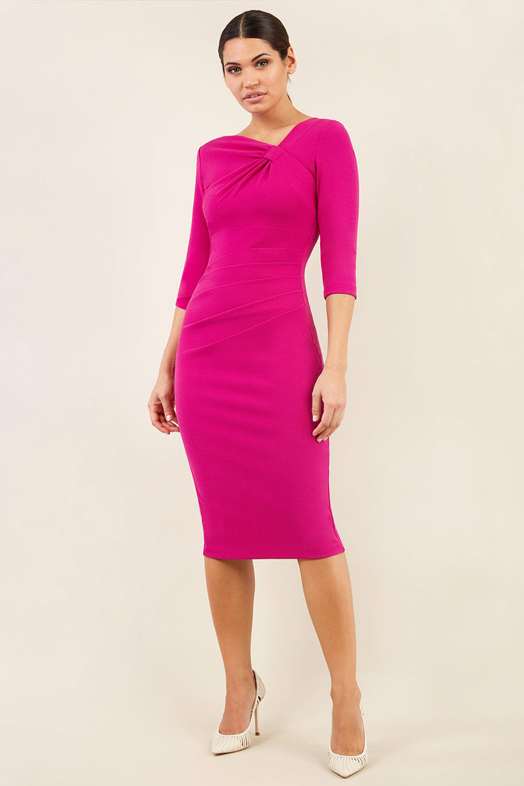brinette model wearing diva catwalk kubrick pencil-skirt dress with sleeves and asymmetric neckline in magenta haze front