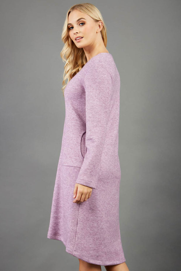 blonde model wearing diva catwalk irena cosy sleeved knee length dress with pockets and v-neckline in soft fabric pink front