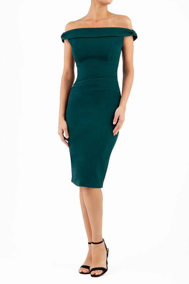 Model wearing the Diva Cloud Luxury Moss Crepe dress with cold shoulder design in forest green front image