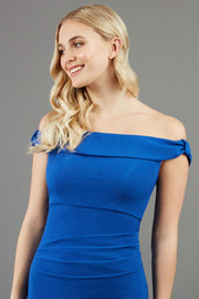 model wearing diva catwalk cloud pencil fitted flattering dress off shoulder sleeveless with detail with pleating around the front in cobalt front