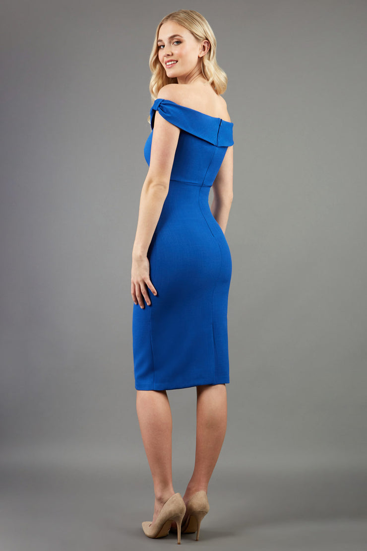 model wearing diva catwalk cloud pencil fitted flattering dress off shoulder sleeveless with detail with pleating around the front in cobalt back