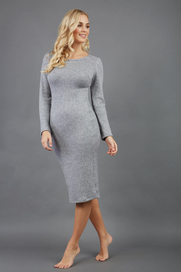 blonde model wearing diva catwalk elstar pencil plain dress made of very soft and cosy cashmere fabric with long sleeves in grey front