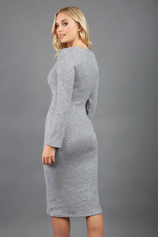blonde model wearing diva catwalk elstar pencil plain dress made of very soft and cosy cashmere fabric with long sleeves in grey back